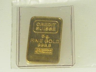 vad väger en guldtacka